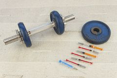 Steroids, muscle-building, dangerous sport Royalty Free Stock Images