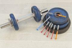 Steroids, muscle-building, dangerous sport Stock Photography