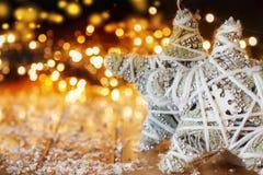 Sterrenvod voor Kerstmislichten op houten achtergrond stock foto
