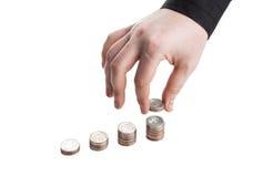 sterta monety i ludzka ręka obrazy stock