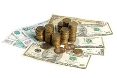 Sterta monety na banknotach Zdjęcie Stock