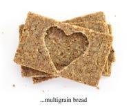 Sterta multigrain plasterki chleb, z cięcia out kształtem serce Obrazy Royalty Free