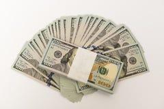 Sterta pieniądze w USA dolarach spienięża banknoty Obrazy Stock