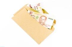 Sterta tajlandzki banknot na brązie rozwija Obrazy Stock