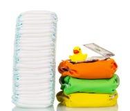 Sterty rozporządzalne i sukienne pieluszki, pieniądze, gumowa kaczka odizolowywająca Fotografia Royalty Free