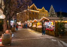 The colorful christmas market in Vipiteno in the evening. Trentino Alto Adige, Italy. Sterzing is a comune in South Tyrol in northern Italy. It is the main stock photography