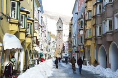 STERZING, ITALY - JANUARY 23, 2018: winter time in cozy mountain town of Europe. Old medieval mountain village with snow. People in main street of Sterzing in Stock Photography