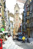 STERZING, ITALY - JANUARY 23, 2018: winter time in cozy mountain town of Europe. Old medieval mountain village with snow. People in main street of Sterzing in Royalty Free Stock Image