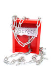 Stess management. The word stress,chained to an emergency box, on a white background royalty free stock photo