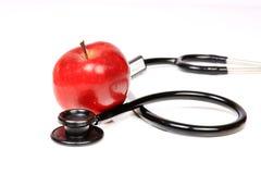 Stethoscoop en appel Stock Afbeelding