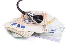 Stethoscoop en euro Stock Afbeeldingen