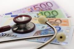 Stethoscoop en euro Stock Foto's