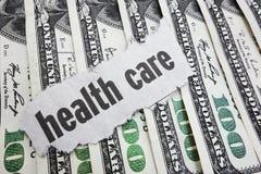 Stethoscoop en geldsymbool voor gezondheidszorgkosten of medische verzekering Royalty-vrije Stock Foto