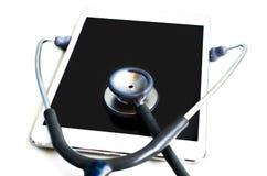 Stethoscoop met tabletcomputer stock afbeeldingen