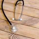 Stethoscoop op houten achtergrond Royalty-vrije Stock Fotografie