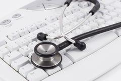 Stethoscoop op toetsenbord Stock Fotografie