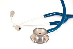 Stethoscoop op wit Stock Foto