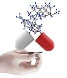 Stethoscoop ter beschikking met capsulepil en molecule Stock Foto