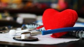 Stethoscoop voor arts en rood hart Royalty-vrije Stock Fotografie