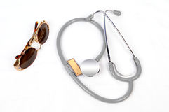 Stethoscope. And sunglasses with white background Stock Images