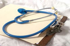 Stethoscope 2. Stethoscope on top of doctor clipboard and scrubs Stock Photography