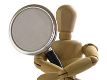 Stethoscope. Wooden mannequin holding a stethoscope Royalty Free Stock Photography