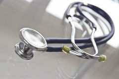 Stethoscope. A stethoscope on a glass table Royalty Free Stock Images