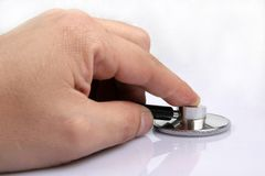 Stethoscope. Hand with a medical stethoscope Royalty Free Stock Images