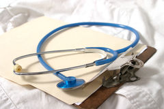 Stethoscope 3. Stethoscope on doctor clipboard and scrubs Royalty Free Stock Photo