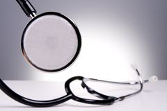 Stethoscope. Isolated medical stethoscope in the spotlight royalty free stock image