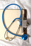 Stethoscope 5. Stethoscope on clipboard and scrubs Royalty Free Stock Photos
