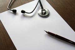 Stethoscope. Prescription shhet, pen and scope stock photos