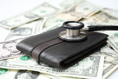 Stethoscope above a wallet royalty free stock image