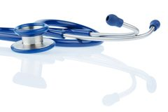 Stethoscope against white background Royalty Free Stock Photos