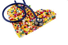 Stethoscope And Pills In Heart Shape Stock Photos