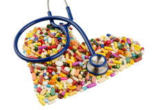 Stethoscope And Pills In Heart Shape Royalty Free Stock Image