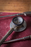 Stethoscope on antique book. Stock Photos