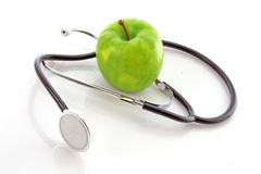Stethoscope and  apple Royalty Free Stock Images