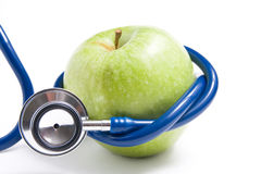 Stethoscope with apple Royalty Free Stock Image