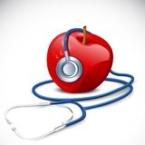 Stethoscope on Apple Royalty Free Stock Image