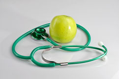 Stethoscope and apple Stock Photography