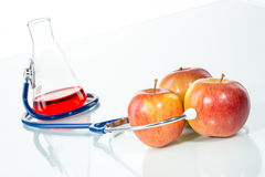 Stethoscope with apple, analytical Royalty Free Stock Image