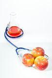 Stethoscope with apple, analytical Royalty Free Stock Photos
