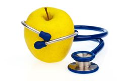 Stethoscope and apple. healthy eating Royalty Free Stock Photo