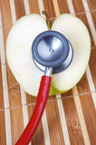 Stethoscope and apple with a heart shape Royalty Free Stock Photography