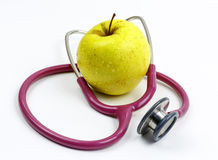 Stethoscope and an apple Stock Photo