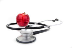Stethoscope with an apple Royalty Free Stock Photos