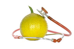 Stethoscope around Gac fruit Royalty Free Stock Photo