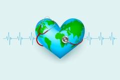 Stethoscope around hearth shaped world Stock Photo