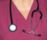 Stethoscope around a nurses neck Royalty Free Stock Image